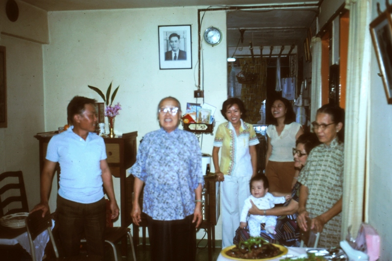Singapore – Ah Loke and her sister-in-law, Ah Bang with family.  (The photo above Ah Loke's head is her brother.)